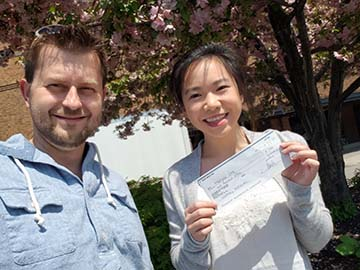Maegan Ong, Mold Busters Scholarship Winner, Receives Check from Michael Golubev